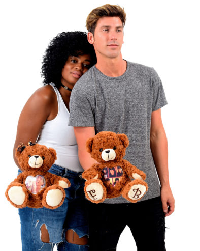 This is an image of a couple with 2 Cuddlebuddys bears